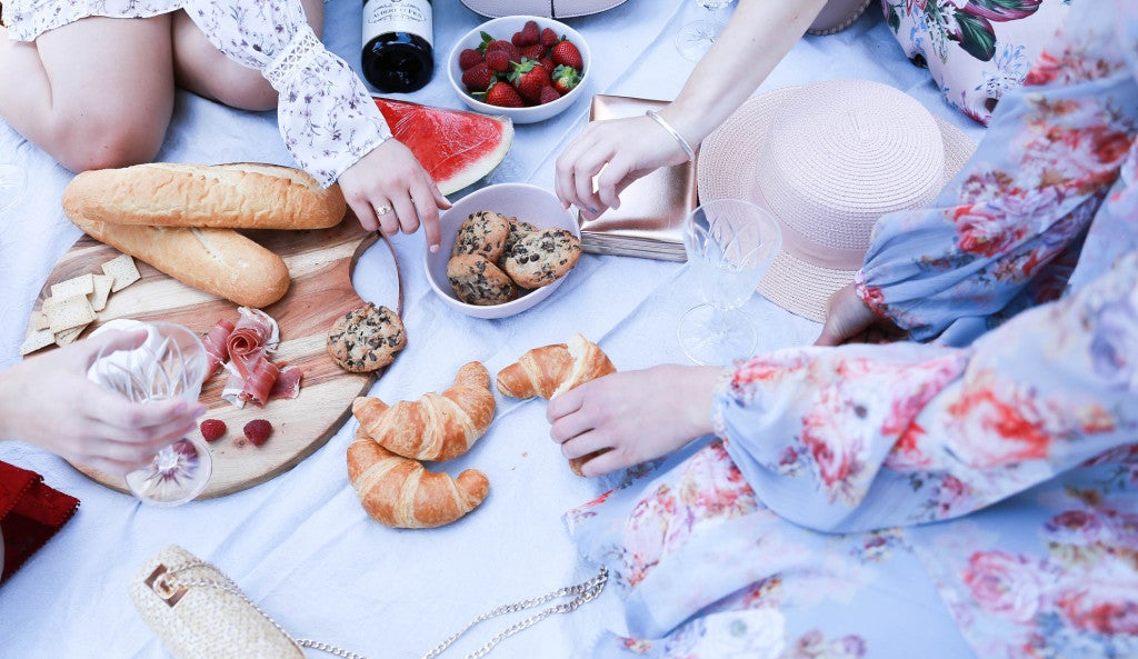 Girls having picnic in park.